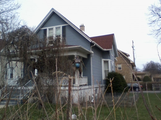 I saw this cool house on a recent Evanston walk.  It looks like an earth goddess hanging from the porch.