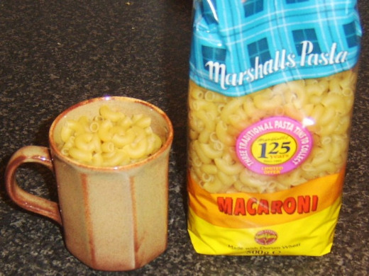 Measuring out macaroni for cooking