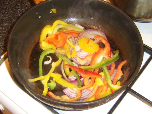 Stir frying bell peppers and red onion