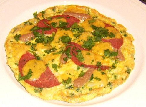 Mini sausages, slices of salami and macaroni in a duck egg based frittata