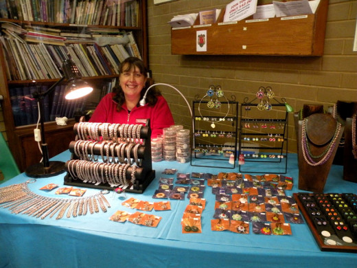 Rose' stall with Rock Rat earrings, her own divine glass pendants and chainmail bracelet creations.
