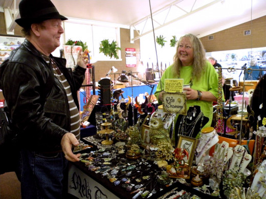 Mel discusses her treasures with a customer.