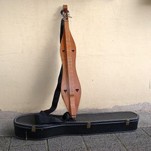 The elongated fiddle known as a dulcimer.
