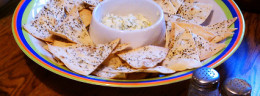 Cheese and fresh chive dip, served here with cilantro rosemary tortilla crisps.