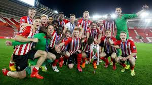 The Southampton Under 21 team celebrating their cup win on Monday night