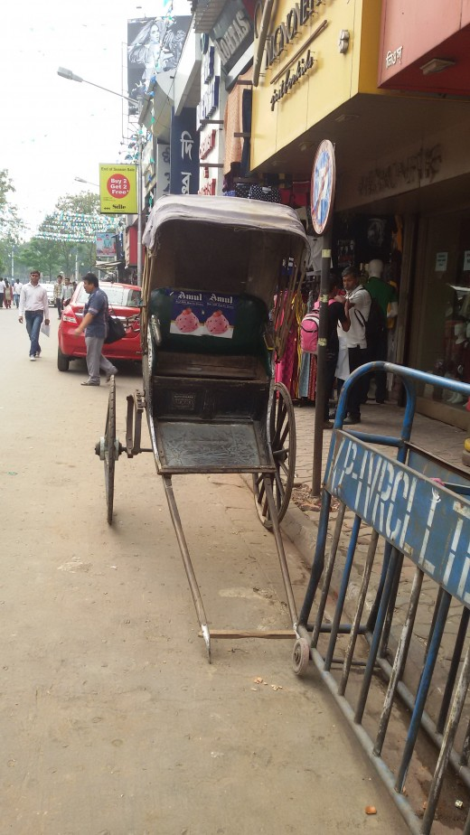 Hand pulled Rikshaw by human - only found in Kolkata