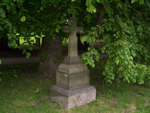 This cross in the churchyard is a memorial to the cholera victims who were buried in a mass grave