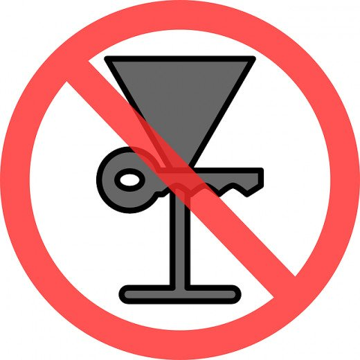 do not drink and drive clip art of a martini glass and keys and red slash over the two together