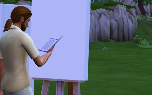 Ishmael reads in front of his easel.