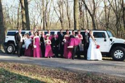 Prom friends get ready to board the limo.