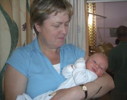 A newborn baby, 12 hours old, in a National Health Service neo-natal ward in London, and his proud grandmother