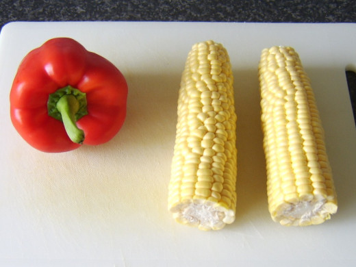 Red bell pepper and two ears of sweetcorn