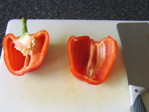 Bell pepper is halved and seeded