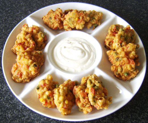 Fritters are arranged on serving plate