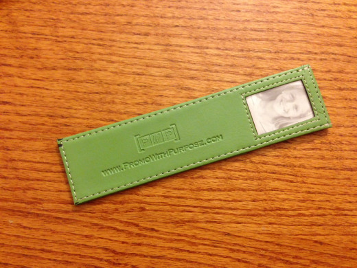 Bookmarks to promote a book can be a cheap as a few cents each up to several dollars each (such as this leather-like design).
