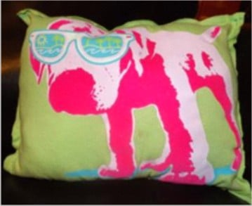 Don't part with those favorite, outgrown t-shirts. Make something from them -- like this cute pillow -- instead!