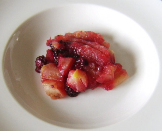 Apple and blackberry filling is laid on a serving plate