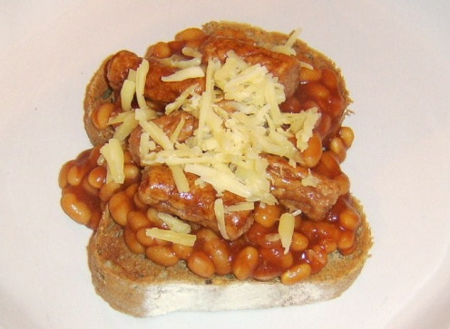 Baked beans on toast with sausages and cheese