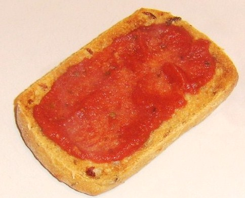 Tomato sauce spread on toasted ciabatta