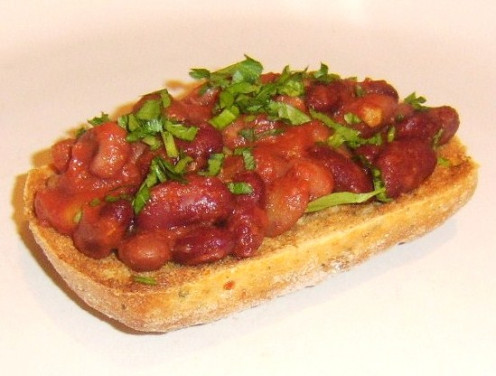 Italian five bean salad in tomato sauce on toast