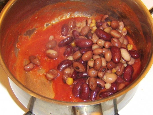 Five bean salad is added to tomato sauce