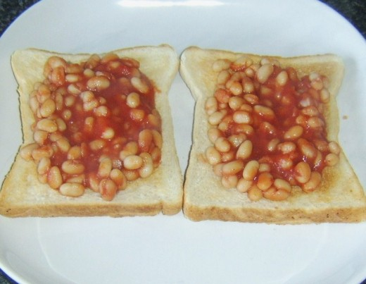 Beans in spicy tomato sauce are spooned on to toast
