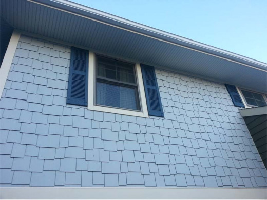 Fiber cement shingle siding