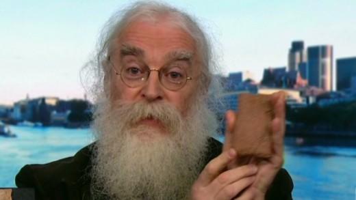 Irving Finkel holding the Babylonian tablet.