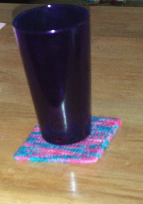 Colorful cross stitched coasters are a nice touch.