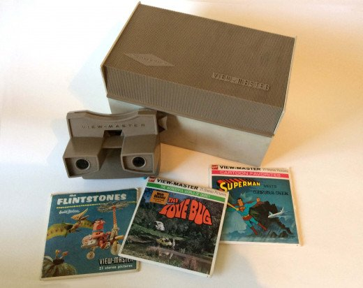Model G View-Master, introduced in 1962, with some typical reel topics based on pop culture and period storage case