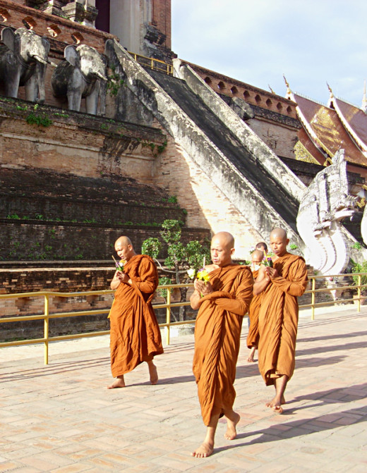 Buddhists monks performing ceremony during Khao Phansa (the Buddhist equivalent of Lent)