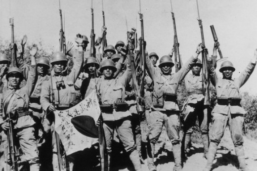 Japanese troops celebrating victory over the Chinese defence forces outside Beijing (1937).