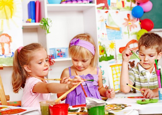 Children should be doing messy projects at preschool, unencumbered by princess gowns. The girl in the middle is dressed for a party, not a day of running, jumping, playing, and painting.