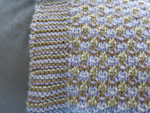 The clean front edge created by tacking the twisting yarn to the back of the blanket.