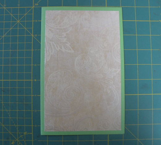 Bottom layer adhered to card