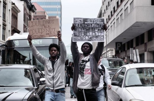 Protesters over the death of Freddie Grey walk admits the streets if downtown Baltimore