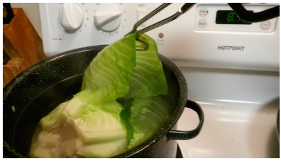 2. Place cabbage into a pot of boiling salt water for 5 minutes before removing leaves with a tong.