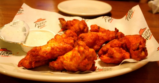 Wings are just one of the many different foods Pizza Hut now serves besides pizza.