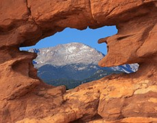 Pikes Peak viewed through red sandstone