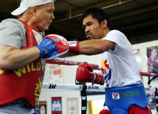 The world champ training with his coach, Freddie Roach in preparation for the mega-fight against Floyd Mayweather.