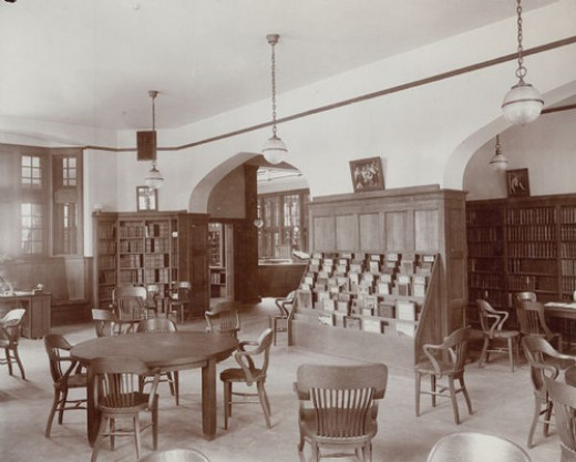 the interior of the Madison Public Library in Wisconsin (Wisconsin Historical Society). The library opened in 1905 and was funded by a $75,000 gift from Andrew Carnegie.