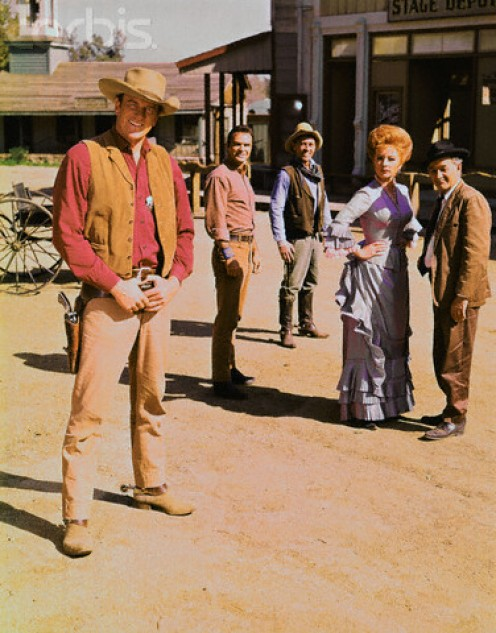 "Cast of Gunsmoke-- James Arness, ""Matt,"" Burt Reynolds, ""Quint,,"" Ken Curtis, ""Festus,"" Amanda Blake, ""Kitty,"" and Milburn Stone, ""Doc."""