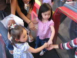 The little girl was as cute as these two, in a pretty pink dress.