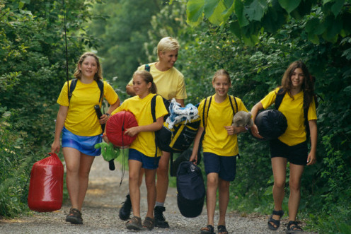 Campers on a hike with chaperone along to make sure they have a safe time.