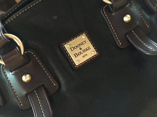 My designer handbag doesn't accurately represent my family's financial situation.