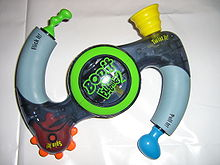 Three incarnations of the game Bop It. The third version just made the second version more colorful and surreal.