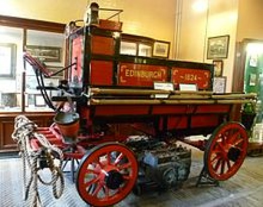 1824 model of manually pulled fire truck
