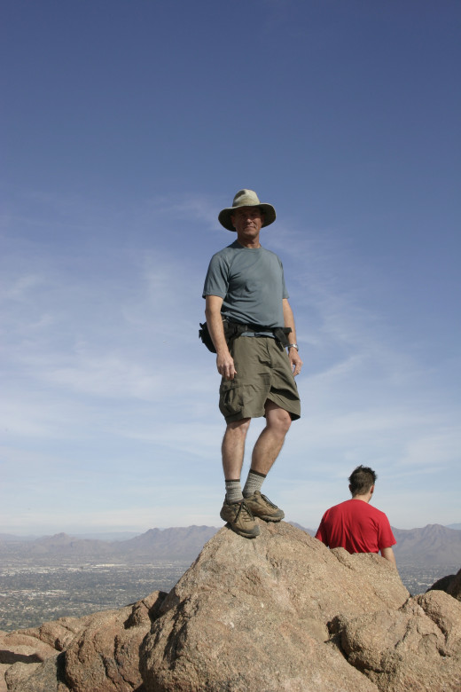 The author stands atop the pinnacle of Camelback Mountain at 2704 feet.