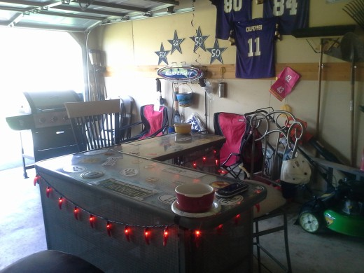 Man Cave - bar, couch, grill, refrigerator