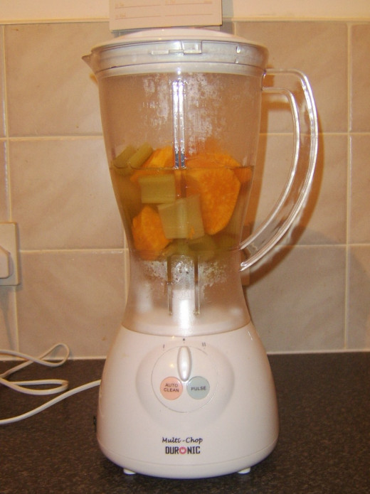 Blending celery, sweet potato and parsnip soup